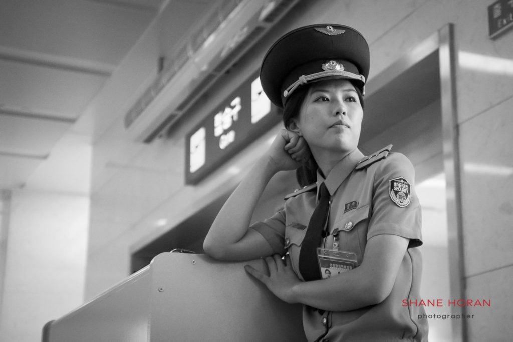 Pyongyang airport security waiting at a departure gate