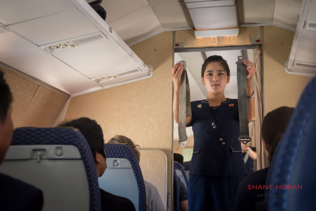 Air Koryo crew give a safety demonstration before take off from Pyongyang airport on board a Tupolev TU 154.