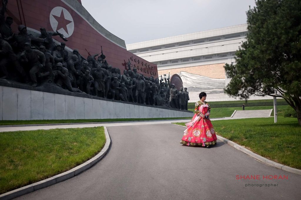 North Korean woman in a traditional choson ot by the Mansudae Grand Monument, Pyongyang, North Korea