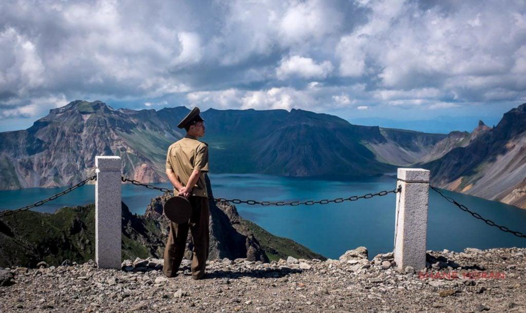Korean peoples army officer at the summit of Mt Paektu, North Korea