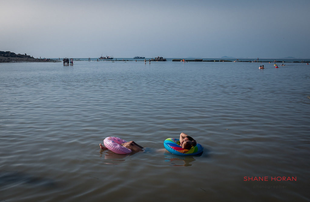 Relaxing at the beach, Nampo, North Korea