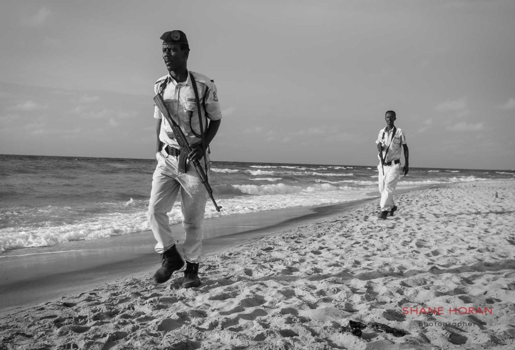 Guards patrol the beach at closing time, Berbera, Somaliland