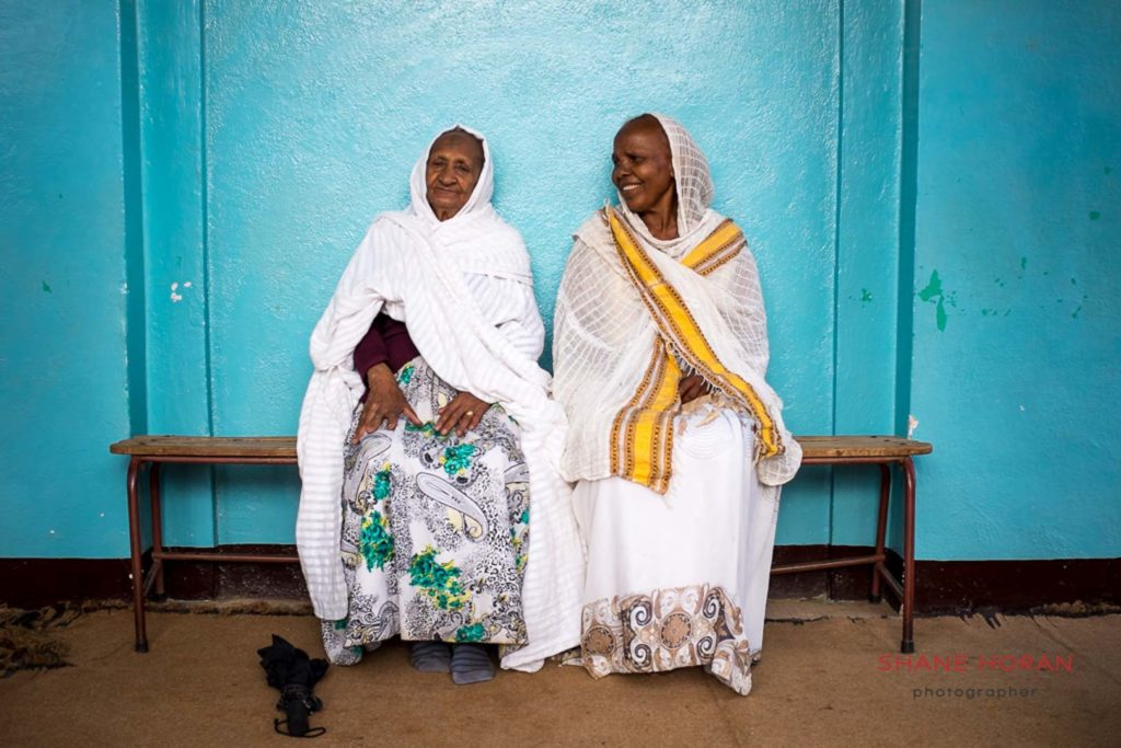 Ladies relaxing outside a church in Asmara, Eritrea