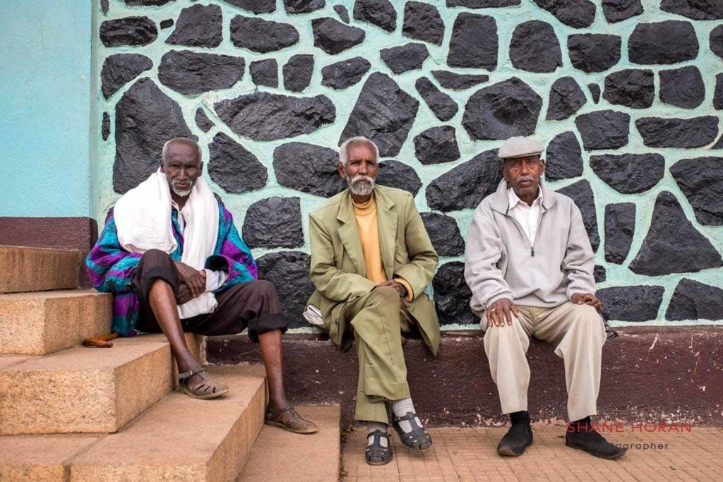 Italian speaking gents outside a church in Asmara, Eritrea
