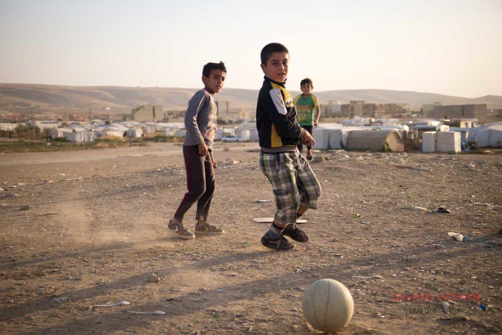 Kids playing football at the Sharia IDP camp, Iraq