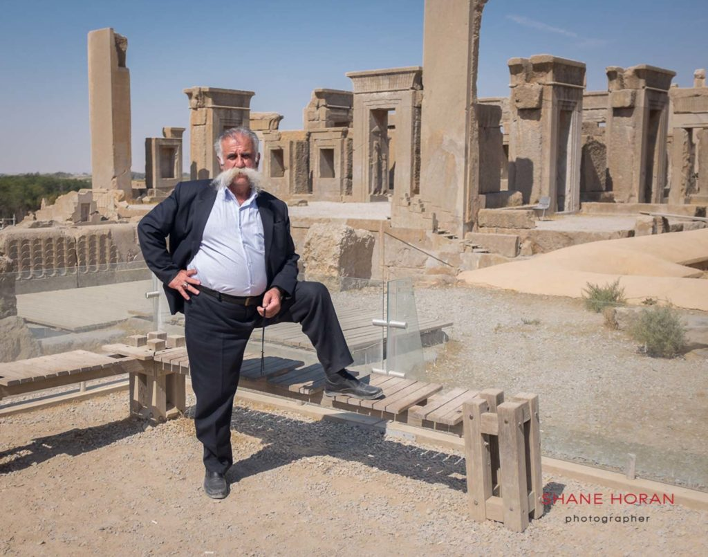 Iranian man posing at the Persepolis site, Iran