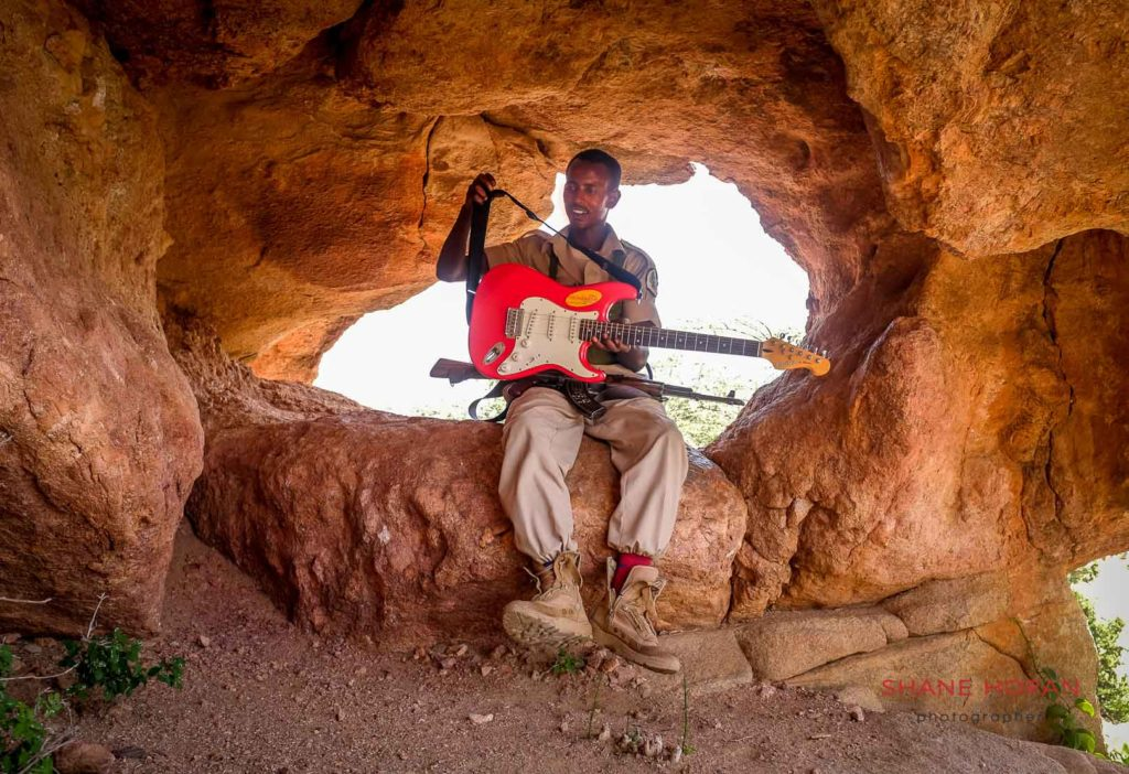 Armed escort takes a load off at Las Geel cave, Somaliland.
