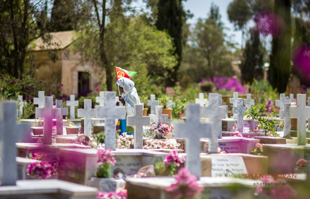 Relative at the grave of a loved one in Asmara, Eritrea
