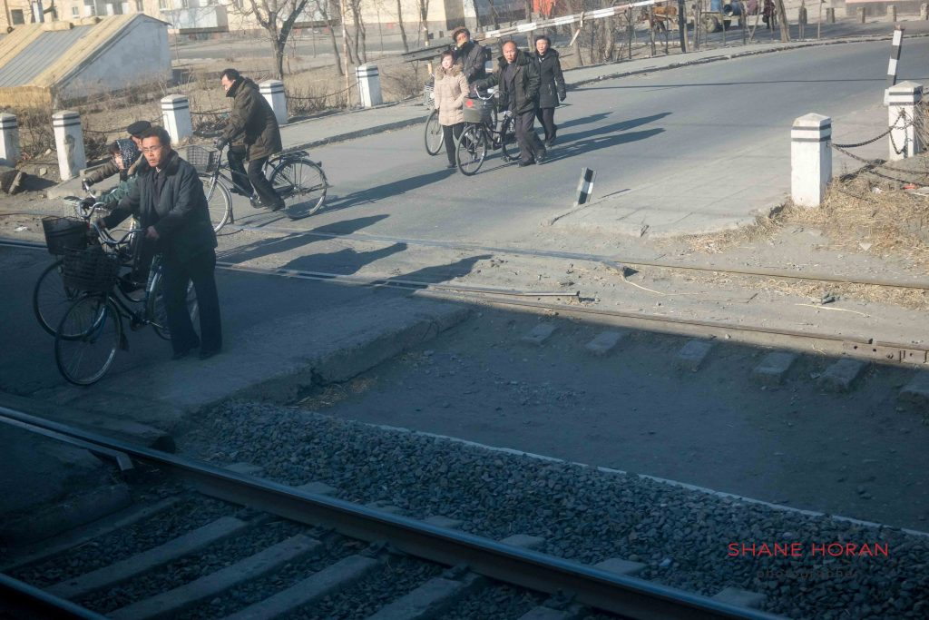 North Korea train passes a level crossing