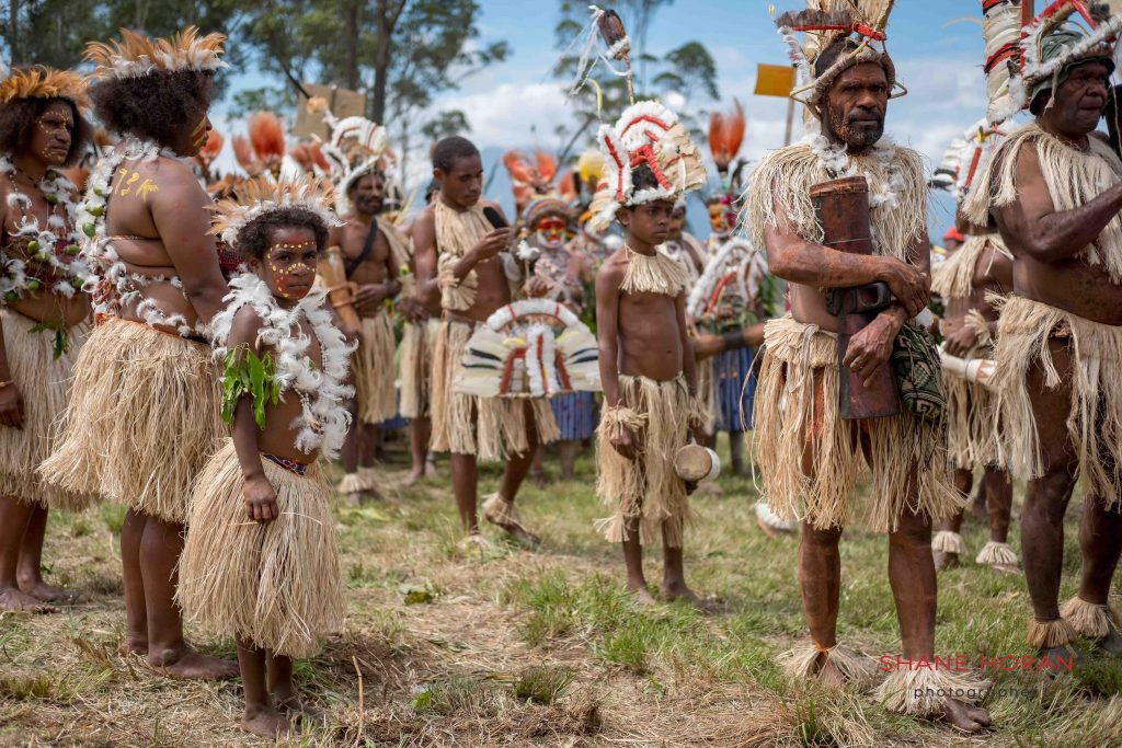 Tribal family ready for the show, Papua New Guinea