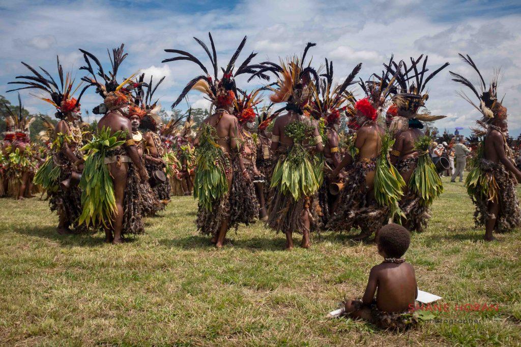 watching child at Mt Hagen, Papua New Guinea