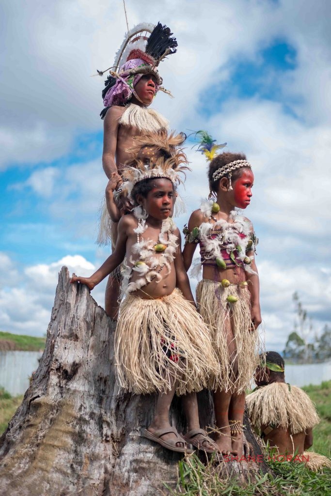Three tribal kids on the lookout, Papua New Guinea