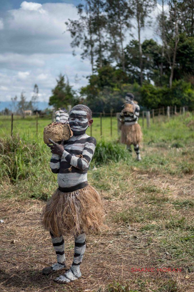 Child waits before the start of the Mt Hagen show, Papua New Guinea