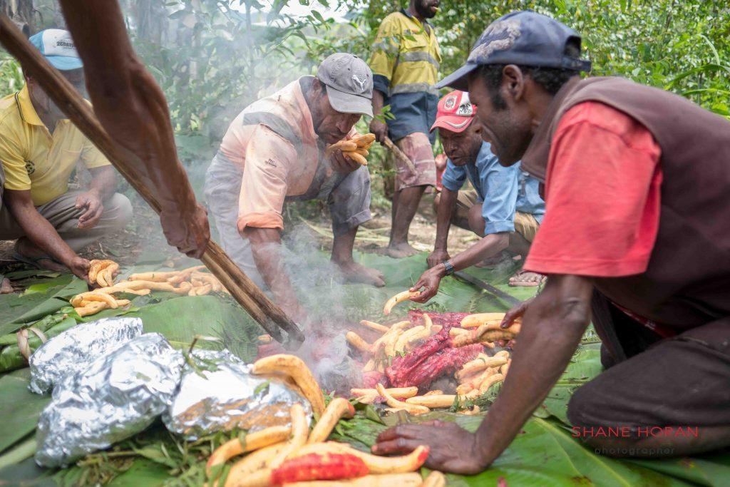 Preparing the Mumu pit, Papua New Guinea