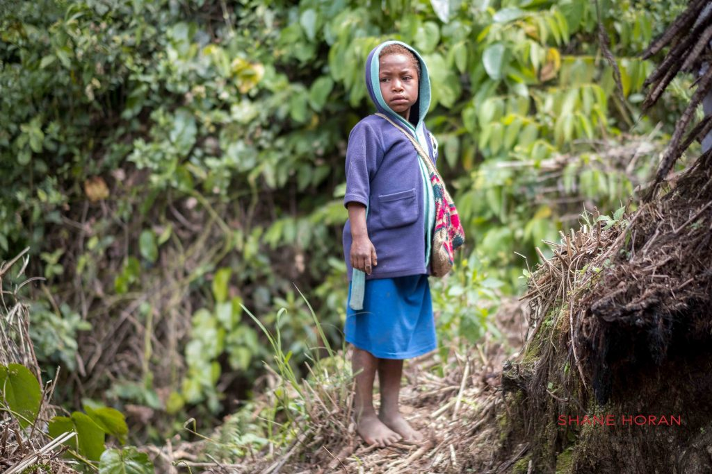 Local Papua New Guinea boy in the central bushlands