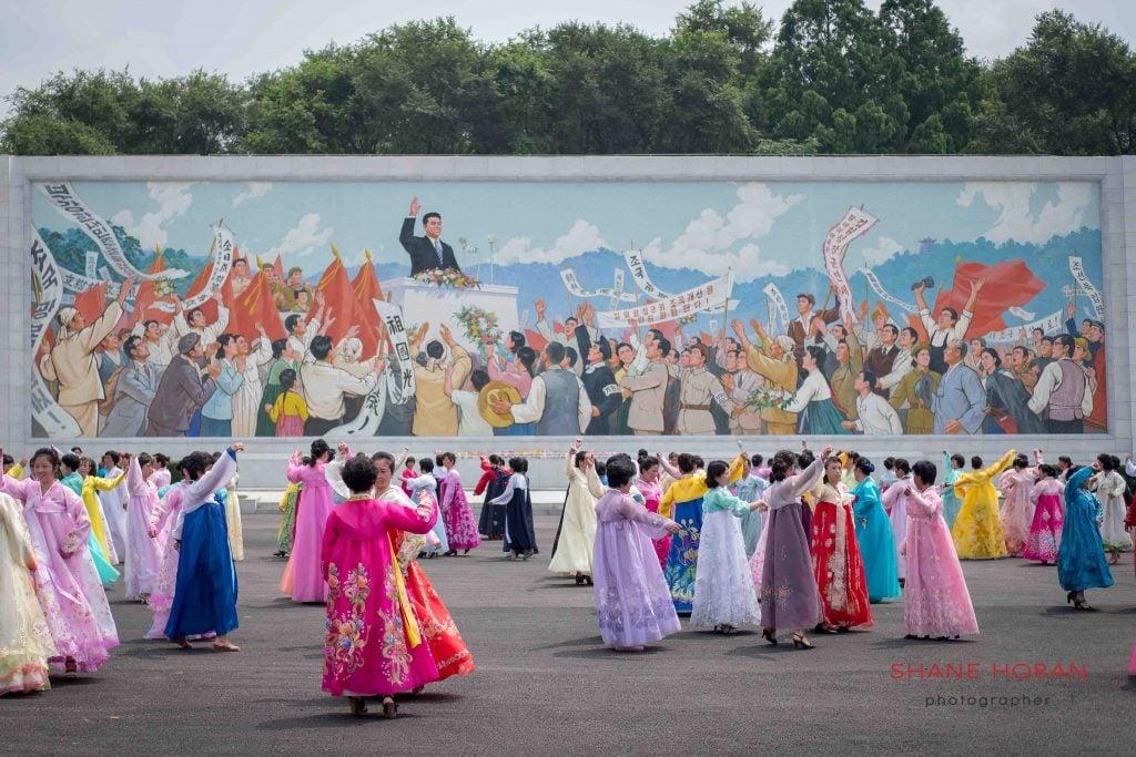 Dancing near the Arch of Triumph, Pyongyang, North Korea