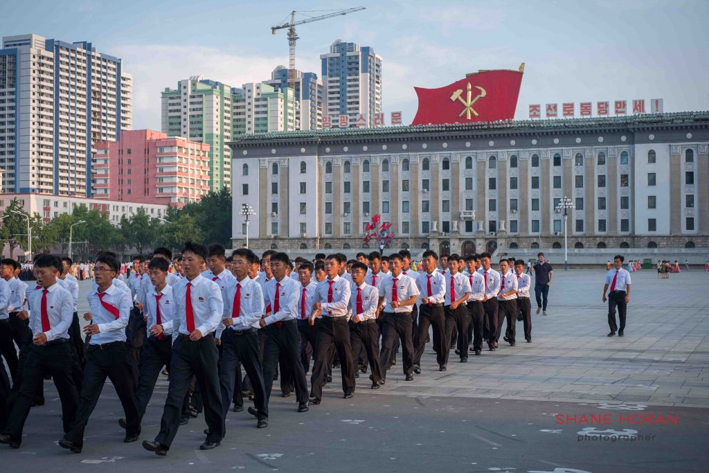 Marching students post mass dance, Pyongyang, North Korea