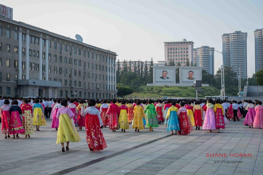 North Korean women leave Kim Il Sung Square after a mass dance, Pyongyang, North Korea